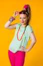 Colorful clothes happy girl with yellow background Royalty Free Stock Photo