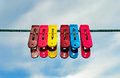 Colorful clothes pegs with blue sky Stock Photos
