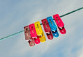 Colorful clothes pegs with blue sky Stock Image
