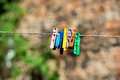 Colorful clothes pegs hanging on a rope Royalty Free Stock Image