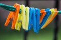 Colorful clothes pegs on a string Stock Photography