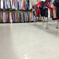 Colorful clothes for sale in a second hand store with empty floor as copy space photo taken with iphone Royalty Free Stock Photo