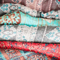 Colorful cloths selection of asian and african as a background Stock Photography