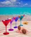 Colorful cocktail in a row with cherry on tropical sand beach of turquoise sea Stock Photography