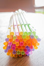 Colorful cocktail straws on wooden table stock photo Stock Images