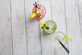 Colorful cocktails set. Mojito , Margarita, red alcohol cocktail on wooden table close up. Royalty Free Stock Photo