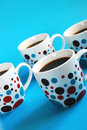Colorful coffee mugs Stock Image