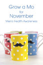 Colorful coffee mugs with mustaches polka dot for november mens health awareness grow a mo sample text Stock Photography