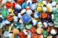 Colorful collection of marbles this grouping consist blue yellow orange and green Stock Photos