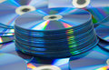 Colorful compact discs set of dvd scattered on a table Royalty Free Stock Images
