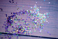 Colorful Confetti in the shape of a heart in front of purple Background Royalty Free Stock Photo