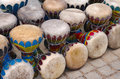 Colorful congas many or hand drums for sale in a handicraft market Stock Photography