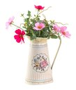 Colorful cosmo flower in vintage style pot Royalty Free Stock Photo