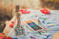 Colorful crayons acrylic paints and bottle with wishes close up Stock Photos