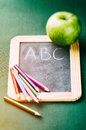 Colorful crayons on blackboard back to school concept Royalty Free Stock Photos