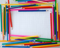 Colorful crayons on checked paper Royalty Free Stock Photo