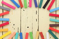Colorful crayons frame on wooden background Stock Images
