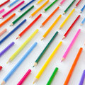 Colorful crayons in parallel lines Royalty Free Stock Photo