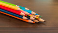 Colorful crayons on wooden table Royalty Free Stock Photos