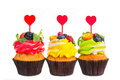 Colorful cupcakes with berries and hearts on a white background. Royalty Free Stock Photo