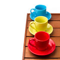 Colorful cups on wooden tabletop Royalty Free Stock Image