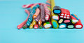 Colorful delicious licorice and chewy candies on wooden board Royalty Free Stock Photo