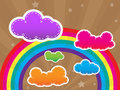 Colorful design with clouds and a rainbow in the b Royalty Free Stock Image