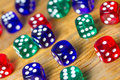 Colorful dices background on wood Royalty Free Stock Photo