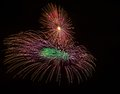 Colorful different colors amazing fireworks in malta dark sky background and house light in the far independence day fireworks Stock Photography