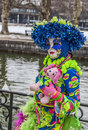Colorful disguise annecy france february enivronmental portrait of a disguised person in a costume posing near a traditional canal Stock Images