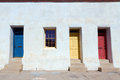 Colorful doors in tucson blue yellow and red on white house at historic district az Stock Photo