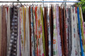 Colorful drapes for sale at street market abstract textile fabric background Stock Photography