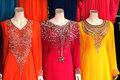 Colorful dresses in dubai a trio of brightly colored a clothing store Stock Image