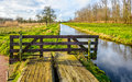 Colorful Dutch autumn landscape with a wooden gate Royalty Free Stock Photo