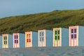 Colorful dutch beach houses wooden in front of dunes Royalty Free Stock Images