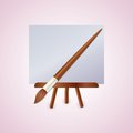 Colorful easel with brush Stock Photos