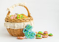 Colorful easter cookies in a basket on white background egg homemade gingerbread the shape of the Stock Images