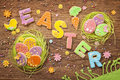 Colorful easter cookies on a wooden background Stock Photos