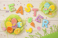 Colorful easter cookies on a wooden background Royalty Free Stock Images
