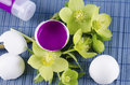 Colorful Easter decoration with egg shell filled with magenta tempera paint and hellebore Royalty Free Stock Photo