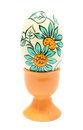 Colorful easter egg in orange cup isolated on white background closeup of painted decoration Royalty Free Stock Photography