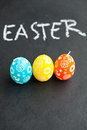 Colorful Easter egg shaped candles and text Stock Image