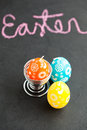 Colorful Easter egg shaped candles and text Royalty Free Stock Photos