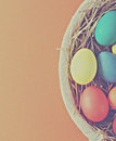 Colorful easter eggs in a basket with hay toning in retro style Royalty Free Stock Images