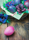 Colorful easter eggs in brown a basket Stock Photos