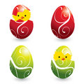 Colorful easter eggs and hatching chicks Stock Images