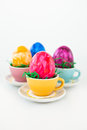 Colorful easter eggs in little cups Stock Photos