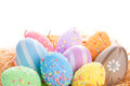 Colorful easter eggs nest over white background Royalty Free Stock Image