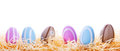 Colorful easter eggs nest over white background Stock Photo