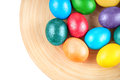Colorful easter eggs on the plate wooden Royalty Free Stock Photos